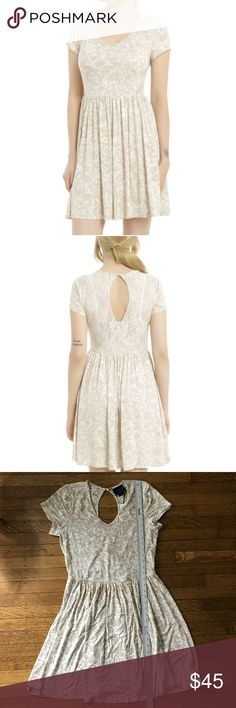 Hot Topic Disney Once Upon a Time Emma Swan dress From the Hot Topic Disney Once Upon a Time collaboration. The emma swan hook dress. Creamy white with accent pattern. Skater style with lace detailing and keyhole back.  New with tags!  Size large - see photographs for measurements - this material does stretch!  —-  I do have a dog who sheds. I lint roll prior to shipping, but it is good to be aware. Hot Topic Dresses Mini