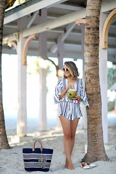 Beach game strong! Layer a striped romper over your bathing suit for a look that will take you from brunch to pool in a snap.