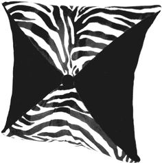"Zebra Zambia Pillow  Wild but sophisticated animal pillows. Elegant Faux Suede, and Faux Fur give this pillow a tasteful touch of unique style. The center Faux Suede button adds an incredible touch of elegance. Back of the pillow is solid Suede with and an animal print button.      Damp Cloth Clean.  None removable cover.  100% Polyester.     Approximately 20"" x 20"".   $79.00  SALE $58.00"