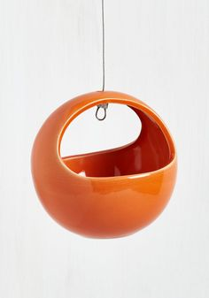 Growing Up Hanging Planter in Persimmon. Give your indoor garden an upgrade by hanging this charming ceramic planter in your place! #orange #modcloth