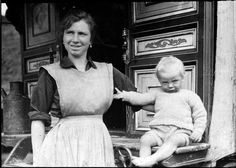 Fairground worker and child    This image comes from a collection of glass slides of fairground scenes found in the stores at Discovery Museum, Newcastle upon Tyne.