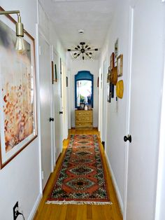 Boho Eclectic Narrow Hallway Decor Do you to make your long narrow entryway or hallway appear bigger? These narrow entryway ideas will help your entryway make a strong first impression. Narrow Hallway Decorating, Narrow Entryway, Hallway Ideas Entrance Narrow, Foyer Decorating, Interior Decorating, Narrow Hallways, Modern Hallway, Flat Hallway Ideas, Long Hallway