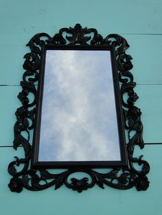 You choose color Large Ornate Vintage Gothic Mirror Wall Mirror Black Hollywood Regency Paris Apartment French Country Romantic Photo Prop. $125.00, via Etsy.