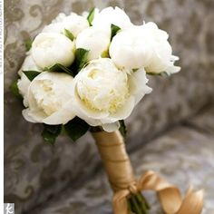 This bouquet is everything I want in a bouquet. Lush white Peony's with gold ribbon.