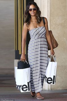 cbce02984b45 Halle Berry appeared effortlessly chic in a striped maxi dress while laden  with large shopping bags