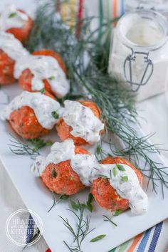 These Salmon Meatballs with Caper Dill Tarter Sauce are a fun (and delicious) way to get more healthy salmon into your family's meals!  Loaded with healthy fats, keto/low carb friendly and made without any gluten or grains!