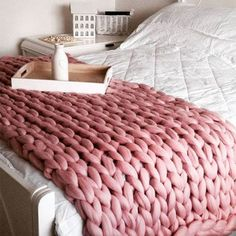 Softly textured, oversized, and inviting - a chunky knit blanket is the home update we never knew we needed. These thick knits bring a splash of contemporary design to any room – use as a throw on your bed, contrast against a wicker chair, or keep on the Giant Knit Blanket, Chunky Blanket, Pink Blanket, Chunky Knit Throw, Chunky Wool, Chunky Knits, Knitted Blankets, Merino Wool Blanket, Knitted Bags