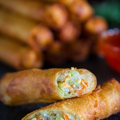 fried spring rolls sliced in half with a glass bowl full of sweet chili sauce next to it. Fried Spring Rolls, Chicken Spring Rolls, Asian Appetizers, Appetizer Recipes, Orange Recipes, Asian Recipes, Oriental Recipes, Chinese Recipes, Spring Roll Calories