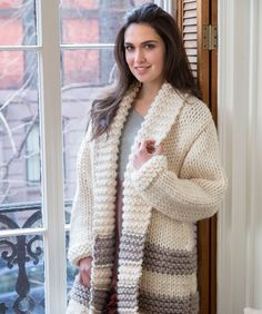 Thick and cosy, this fashionable knit coat is comfortable in the car, on a winter walk or indoors in front of the fire. The super bulky yarn means you can knit a long coat more quickly!