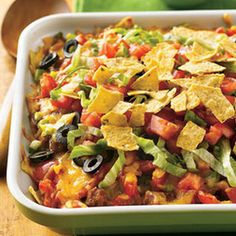 BEEF AND  BEAN TACO CASSEROLE: ~ Shared by Kim M. ~ Tip:1.This is an easy recipe to take and bake. Just save the toppings to take and serve with the hot casserole. In place of the cheddar cheese, try using a taco-flavored cheese.