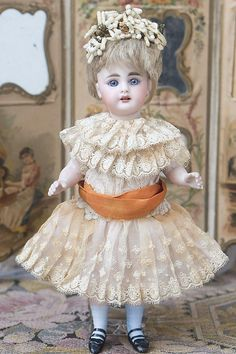 Spectacular and an extremely rare large size 9 all bisque mignonette with wonderful expression from Simon Halbig with original costume. Bisque