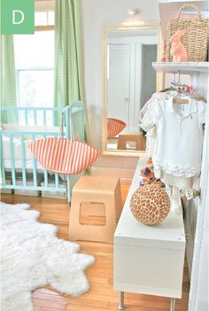 gender neutral nursery, exposed/open closet. mint, green, white, orange