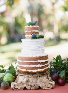 """Featured on Style Me Pretty! Our """"half naked cake"""" by Cloud 9 Bakery in Miami, Fl. www.cloud9bakerycafe.com   naked cake ruffle cake rustic cake unfrosted cake layer cake wedding cake http://www.stylemepretty.com/2014/05/09/floridian-spring-wedding-inspiration/"""