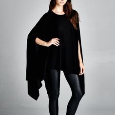 """Memento"" Loose Poncho Tunic Top Loose fit, round neck asymmetrical hem poncho style tunic. Made with medium weight brushed fabric that has a soft fuzzy texture. Soft and drapes well. Similar to our ""contemporary"" tunic but much warmer for cooler days. 67% polyester 29% rayon 4% spandex. One size fits most. Available in black and ivory. This listing is for the BLACK. Bare Anthology Tops Tees - Short Sleeve"