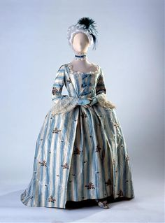 Robe à l'anglaise with matching shoes, circa 1765, English, striped silk taffeta brocade. Flower detail is woven, not embroidered. Brought from Belfast, Ireland in 1873 by the Blizard family, who were originally from Normandy, France.