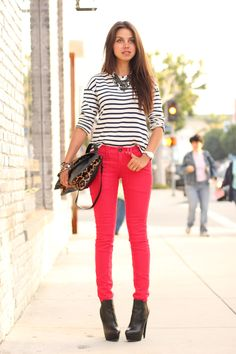 striped shirt, red jeans and animal print handbag
