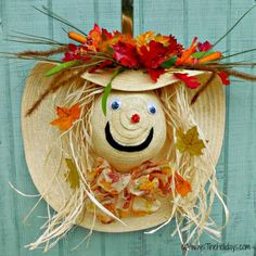 This adorable scarecrow autumn wreath door decoration is so much fun to do. I used an old gardening hat to make mine and some supplies from the Dollar store.
