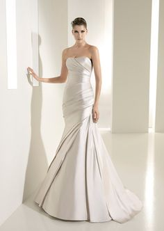 White One Tigris - 40% off sample gown Sunday, August 26th. Visit www.missrubyboutique.com to schedule an appointment