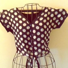Poka Dot Top Black and white, only black on the back. Ties in front. Buttons down the middle. Rather short top. More like a belly top or crop top Rue 21 Tops