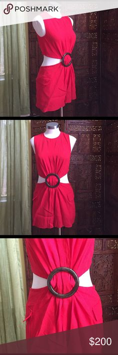 KEMPNER red dot romper Sexy red romper with sinched front. Exposed sides and back. Zipper back for the top and ties for extra fit on top and bottoms. NWT. One of the size 2 does not have a tag with it. Never worn (except on mannequin) open to offers! Kempner Pants Jumpsuits & Rompers
