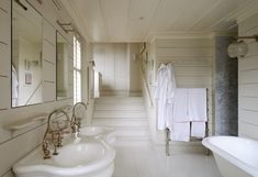 Picture Lights in a Bathroom in London | Remodelista