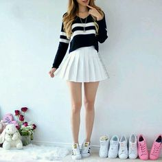 A black sweater with white stripes, featuring a white pleated skirt and Superstar sneakers. A black sweater with white stripes, featuring a white pleated skirt and Superstar sneakers. Teen Fashion Outfits, Cute Fashion, Outfits For Teens, Girl Fashion, Summer Outfits, Fasion, Fashion Beauty, Cute Casual Outfits, Girly Outfits