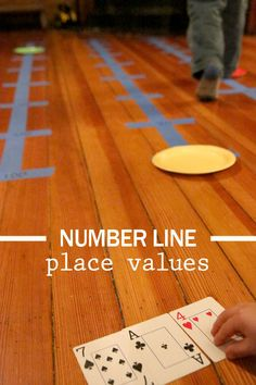 We decided to try a number line activity. Number lines are great for learning numbers, in almost any way you can think of, plus getting the kids moving.