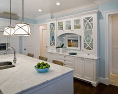 Shallow Refrigerator Kitchen Traditional with Barstools Blue Walls Built in Hutch Dark Wood Floor