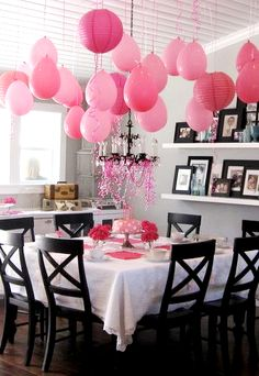 Hang balloons upside down above the dessert table. That will save money on lanterns and Pom poms. Do this with 3 pennies in the balloon before blowing up. Keeps the balloon from swaying and gives it a tear drop look. Mixed pastel colors