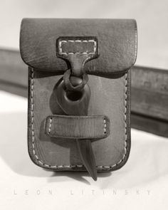 Leather & Wood Pouch Bag by Leon Litinsky.