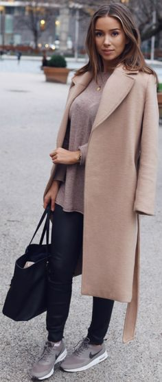.A camel coat will always make a great addition to your cute winter outfits. Emilie Tømmerberg wears this H&M piece over a sweet knit sweater and leather trousers. Coat: H&M, Shoes: Nike