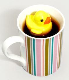 "Tea Duckie. Rubber Duckie you're the one, you make tea time lots of fun! Enjoy your cup of tea with your new floating tea infuser. This 3 piece set includes an iconic yellow duck, metal mesh basket for loose or bagged tea and a lil' holder that looks just like water. Your afternoon tea time is sure to make all those coffee drinkers super jealous! About 3""x6"". $12"