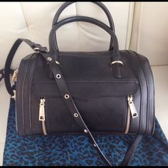 Rebeccaa Minkoff Darcy satchel Rebecca Minkoff Darcy satchel in black. Measures 9 inches (height) x 13 (length) x 6 (depth) with a detachable strap drop of 17 inches. Will ship with original dust bag. Worn only five times and in near perfect condition with the exception of a slight blemish on the handle as seen in the fourth photo. Authentic. Cowhide leather. Currently sold out everywhere. Rebecca Minkoff Bags Satchels