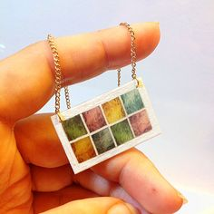 Mardi Gras Transom Necklace -- New Orleans Architectural Detail Jewelry, inspired by stained glass windows  $25 on Etsy