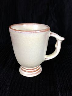 "The Frankoma Pottery C12 Mug: I have four of these in the same Desert Gold glaze. They go very nicely with the Westwind 11"" platters (#6P). (JKT)"
