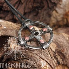 Forged iron handmade Viking style pendant. The pendant is an ancient symbol, the Solar cross, which is probably the oldest religious symbol in the world, appearing in Asian, American, European, and Indian religious art from the dawn of history. Composed of a equal armed cross within