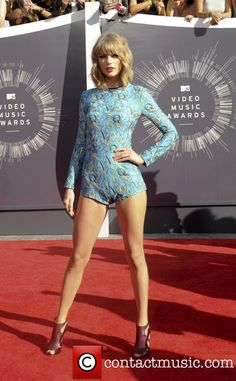 Taylore Swift @ 2014 MTV Video Music Awards wearing a light blue, long sleeve, short, all in one suit