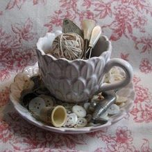 teacup with sewing notions and buttons