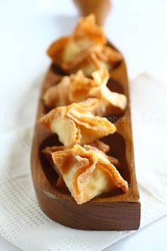 Crab Rangoon - fried wonton filled with cream cheese with tiny bits of crab meat. #appetizer #seafood