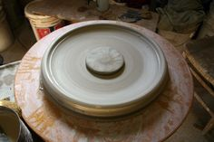 integrate a ball of clay in the center of a large platter to avoid the s-crack.
