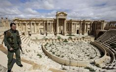 The ancient ruins of Palmyra are still being plundered by looters, under the watch of the Syrian and Russian forces that captured the city from Isil earlier this year, archaeologists claim.