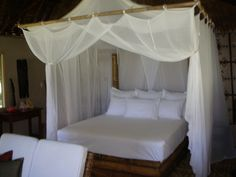 Tropical dreamy white canopy bed. (Tavanipupu Island Resort)