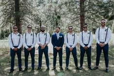 I like the now bow tie. modern couple at hosted their Montana destination wedding at White Raven.Wedding designers and planners Champagne + Linen coordinated it. The groomsmen wore matching loafers, fitted blue suite pants, and suspenders. Groomsmen Attire Suspenders, Rustic Groomsmen Attire, Blue Groomsmen Suits, Bridesmaids And Groomsmen, Groom Attire, Mismatched Groomsmen, Wedding Suspenders, Rustic Wedding Groomsmen, Destination Wedding Groomsmen