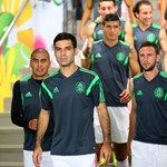 Rafael Marquez (C) and players of Mexico walks in the tunnel