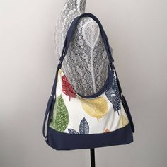 This is a convertible bag that I made from a cotton blend home decor fabric ,with lemon white background and leaves print in variety of colours.I added an extra layer of Persian blue cotton twill to the lower part of the bag for more durability. this light weight and functional bag features convertible straps ,which can be worn as a backpack when you need to have your hands free ,or be carried over one shoulder,with no hassle and no need to change straps. It is lined with a khaki fabric.and…