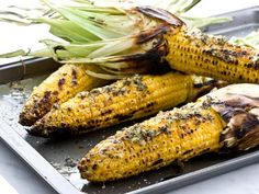 Presentation for corn - keep it casual on a cookie sheet, like it came straight from the grill. but accompany it with the dipping sauce and lime wedges.