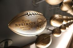 The new Packers Hall of Fame was revamped back on Aug. 21, 2015.   Gone are the commemorative plaques for each inductee; now they are represented by a football engraved with their name, position played,  years active with the Packers, and the year they were inducted