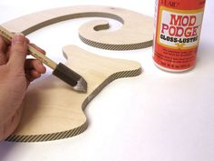 Apply Mod Podge to the face, sides and back edges of the letter