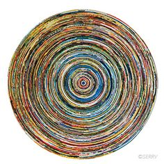 Spiral Plate - Recycled newspapers and magazines have never looked so beautiful. These products are made from multiple layers of rolled, coiled, and lacquered reclaimed paper. Spiraled layers create this large decorative platter. $23