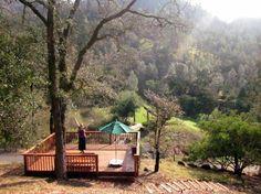 A guest enjoying our yoga deck.    www.calistogaranch.com